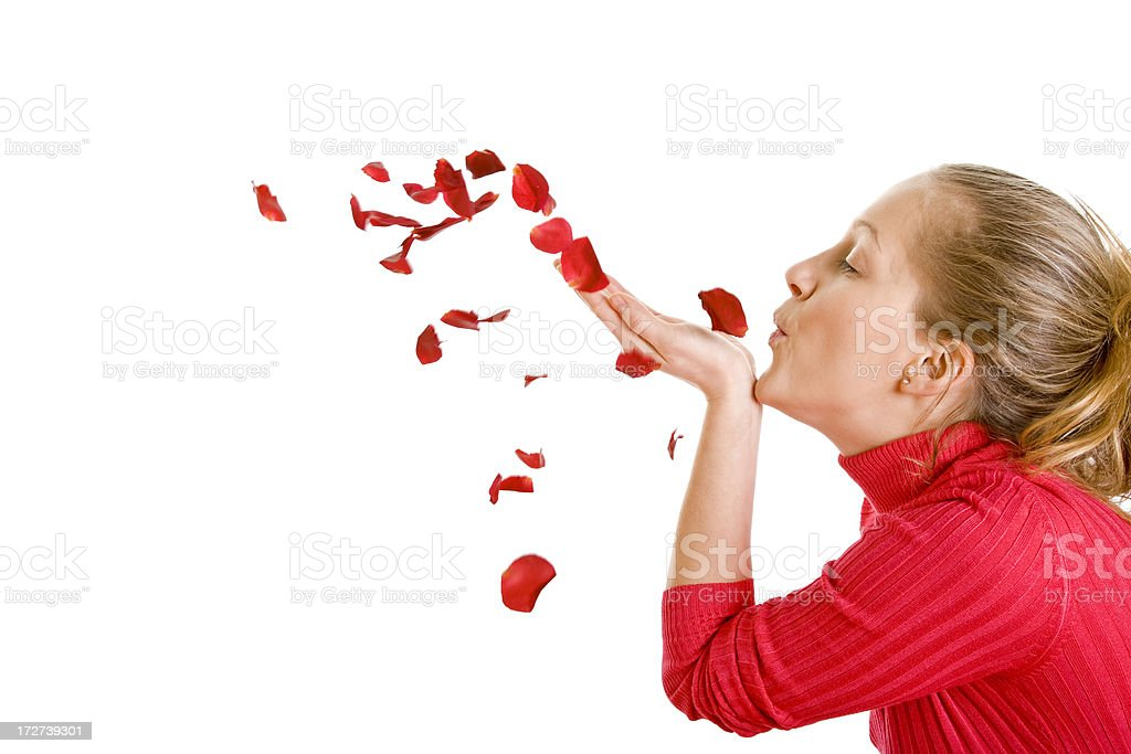 Beautiful woman blowing rose petals isolated on white royalty-free stock photo