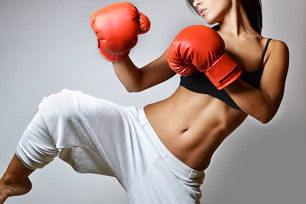 beautiful woman boxing stock photo