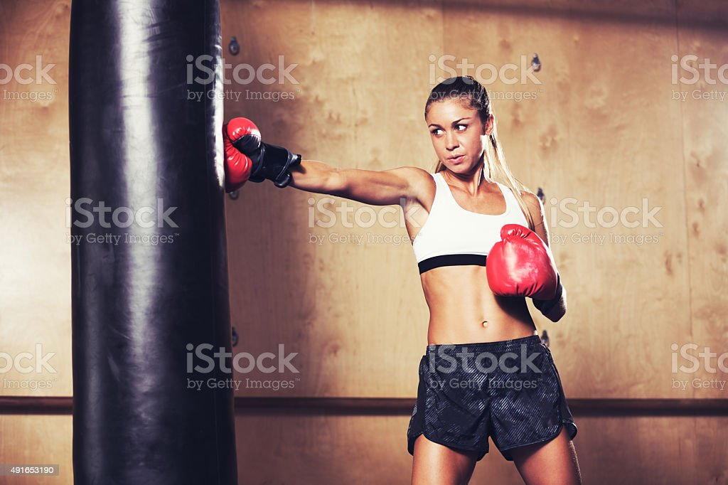 Beautiful Woman Boxing with Red Gloves stock photo