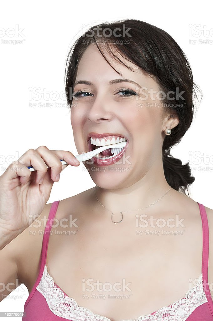 Beautiful Woman Brushing Teeth royalty-free stock photo