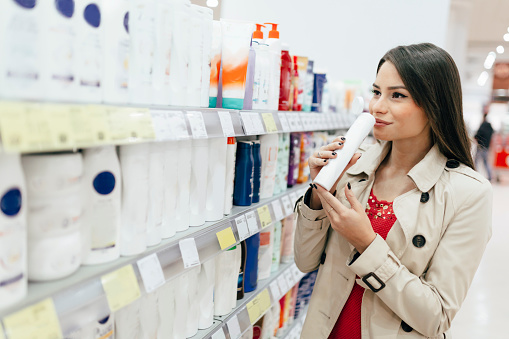 istock Beautiful woman buying body care products in supermarket 665489490