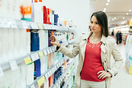 istock Beautiful woman buying body care products 540531260