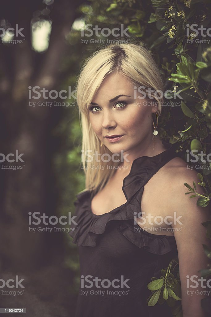 Beautiful woman by a hedge royalty-free stock photo