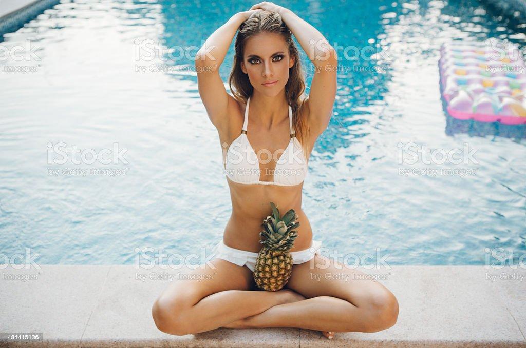 Beautiful woman by swimming pool. stock photo