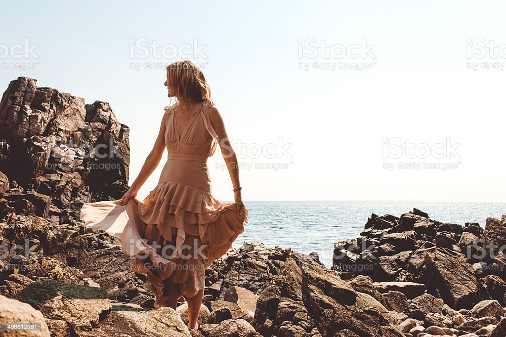 Beautiful woman by the ocean stock photo