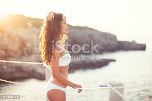 istock Beautiful woman by the sea 522332020