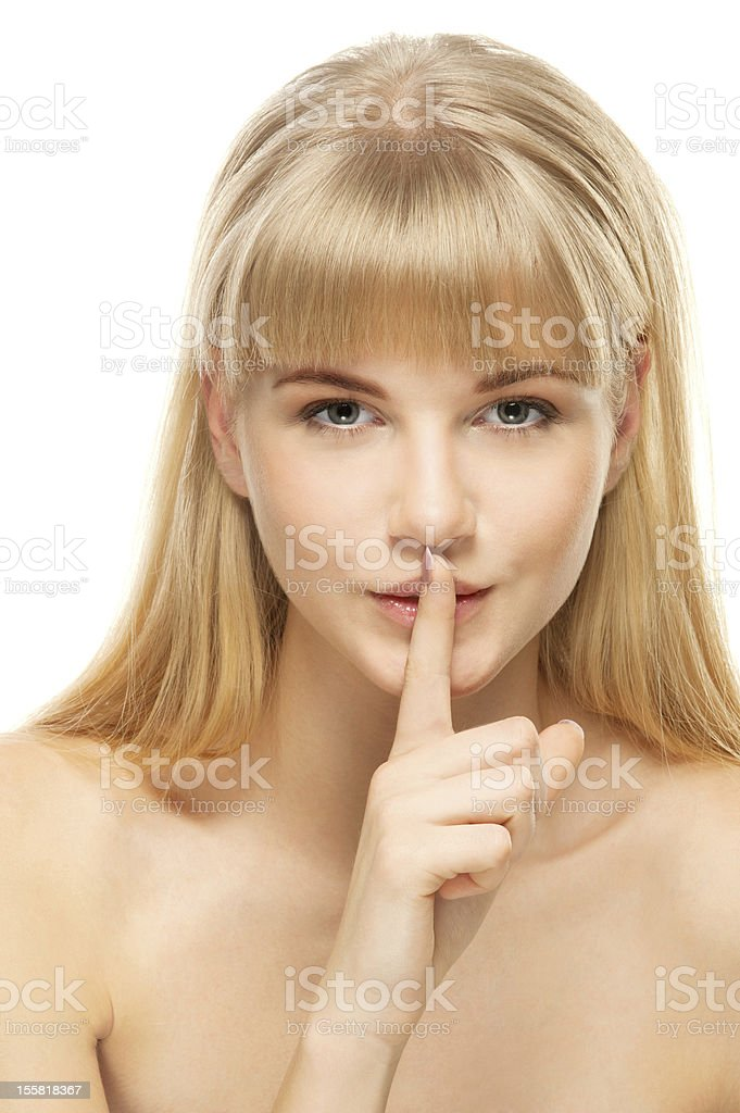 beautiful woman calls for silence royalty-free stock photo