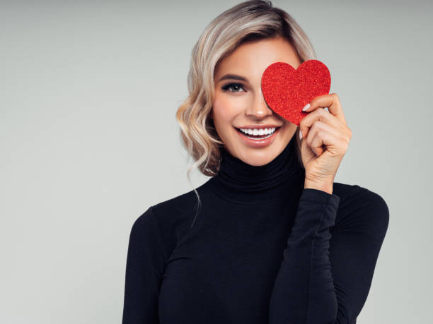 Beautiful woman cardboard heart stock photo
