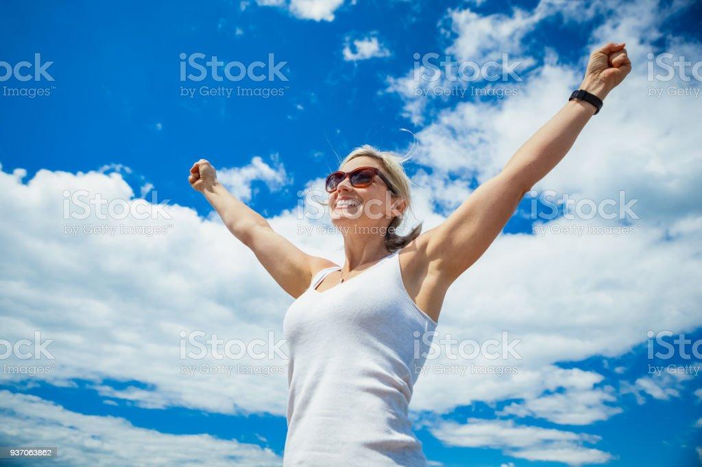 Beautiful Woman Carefree in Blue Sky stock photo