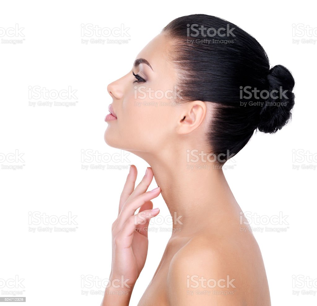 Beautiful woman cares for the neck stock photo