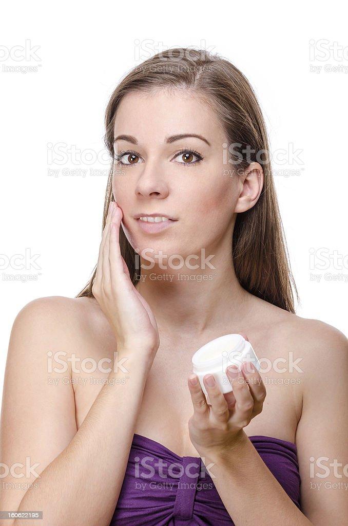 Beautiful woman cares of skin royalty-free stock photo
