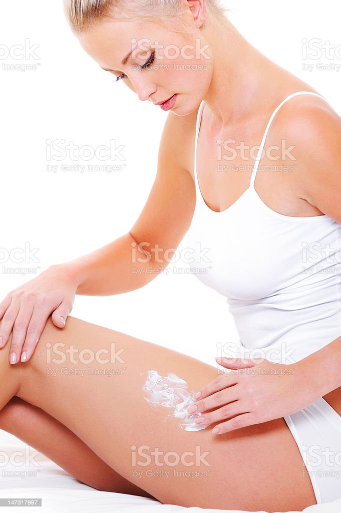 Beautiful woman caring of her legs royalty-free stock photo
