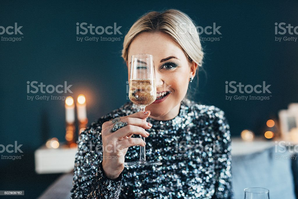 Beautiful woman celebrating new year with champagne stock photo