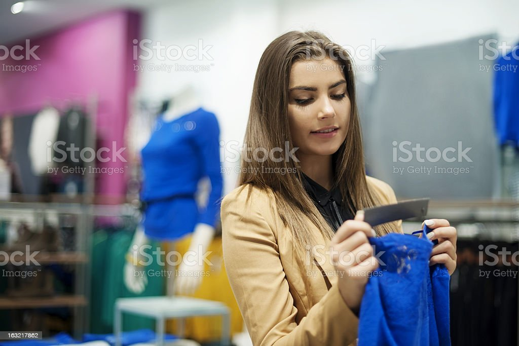 Beautiful woman checking tag in a boutique stock photo