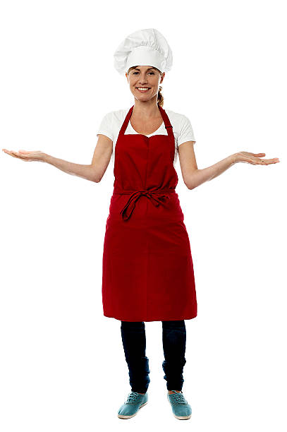Beautiful woman chef welcoming stock photo