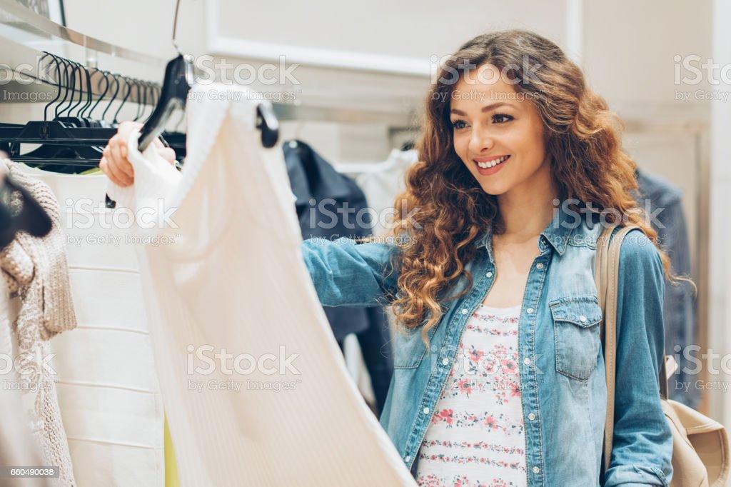 Beautiful woman choosing a new dress stock photo