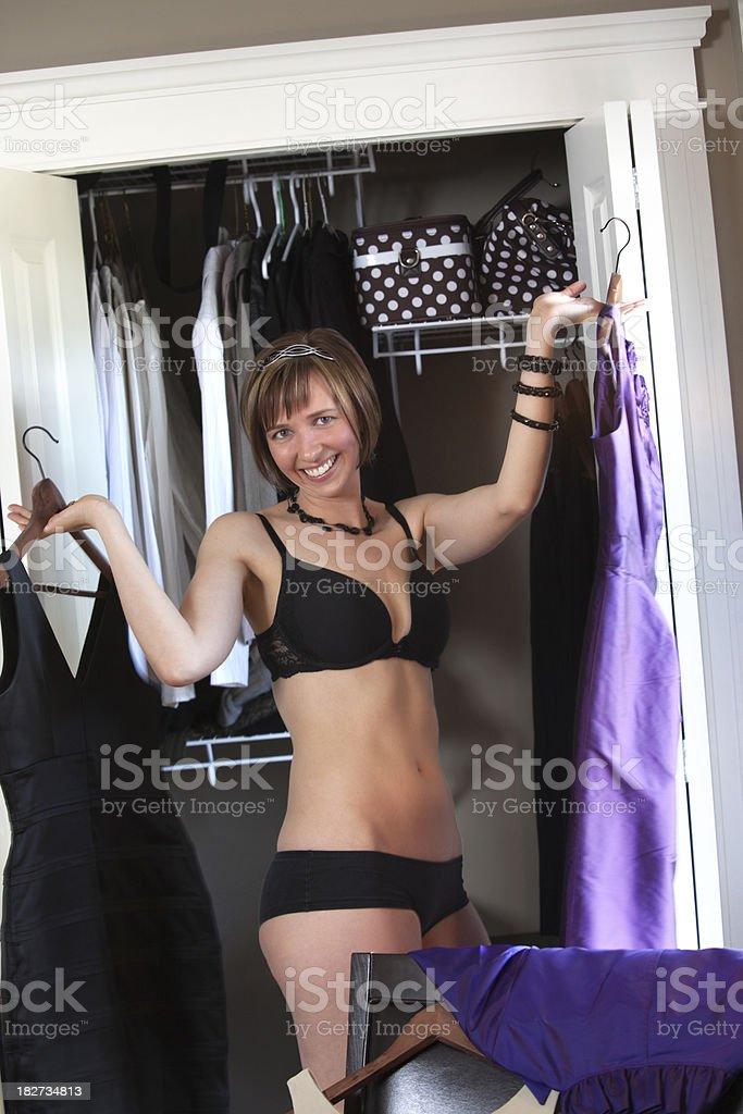 Beautiful woman choosing dresses. royalty-free stock photo