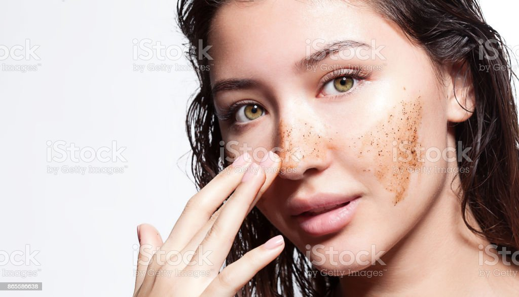 Beautiful woman cleans the skin scrub on a white background isolated stock photo