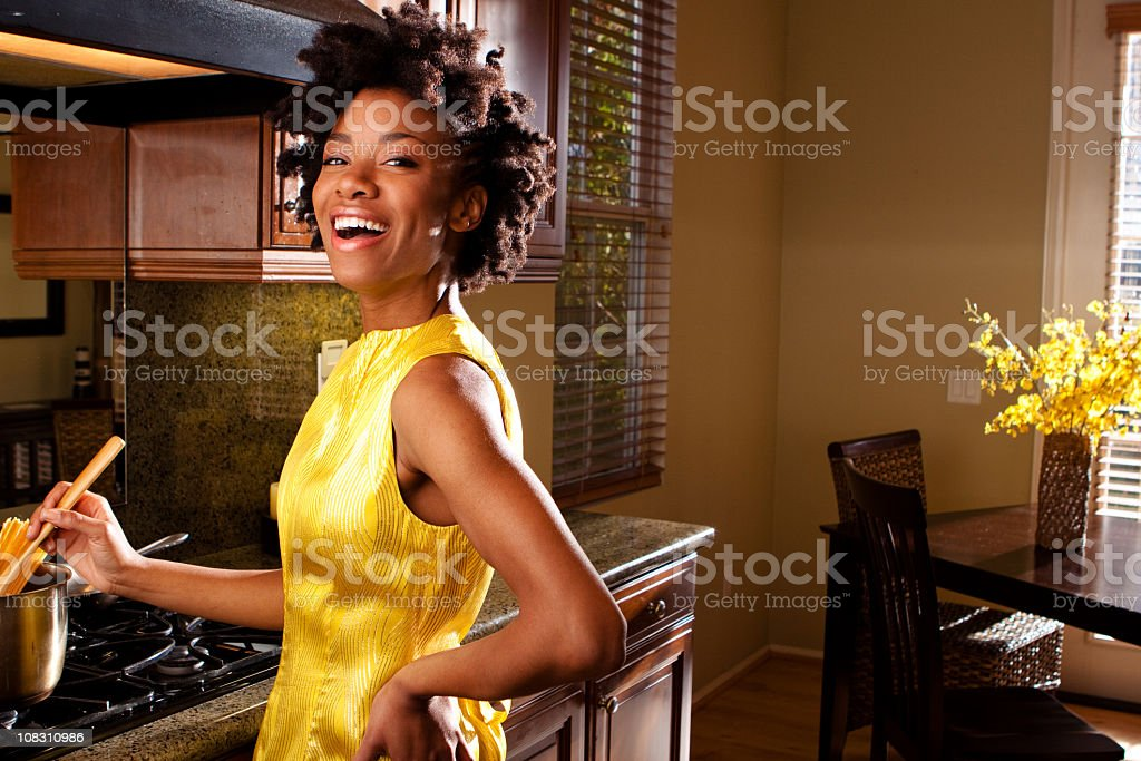 Beautiful woman cooking in the kitchen stock photo