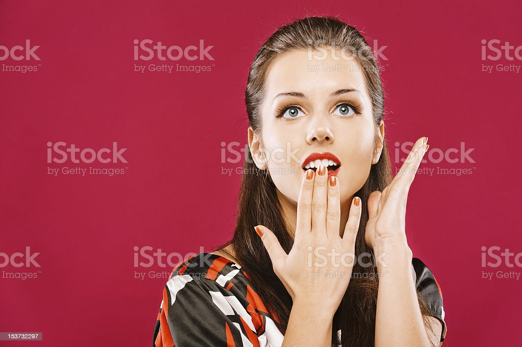 Beautiful woman covers mouth with palm royalty-free stock photo