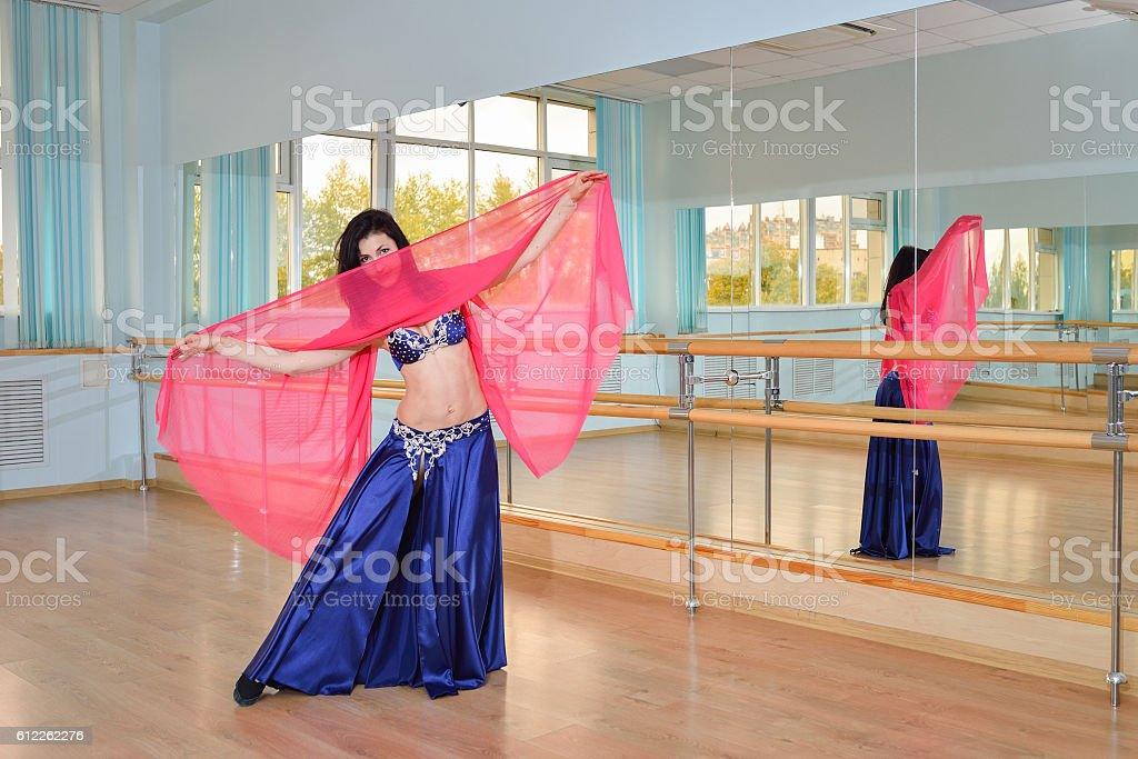Beautiful woman dancing in arabic costume, oriental or belly dance stock photo
