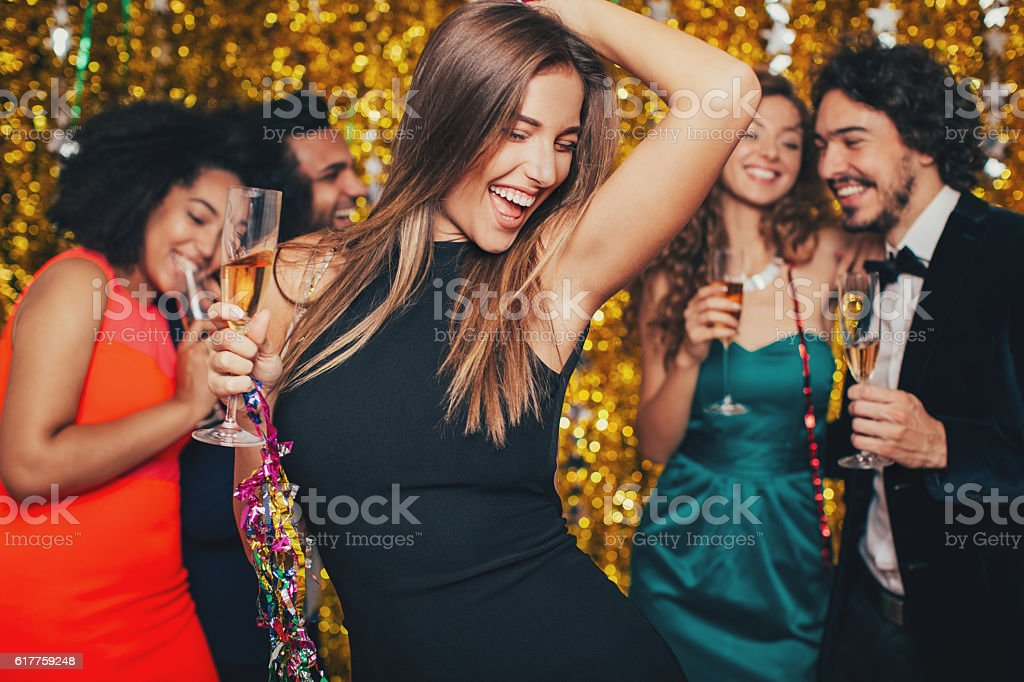 Beautiful woman dancing on a formal party stock photo