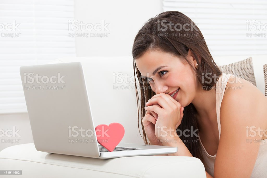 Beautiful Woman Dating Online On Laptop stock photo