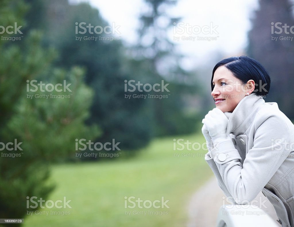 Beautiful woman daydreaming in the garden royalty-free stock photo