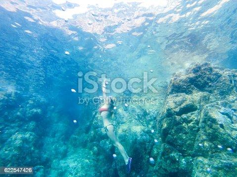 1037450870 istock photo Beautiful woman diving in the sea 622547426