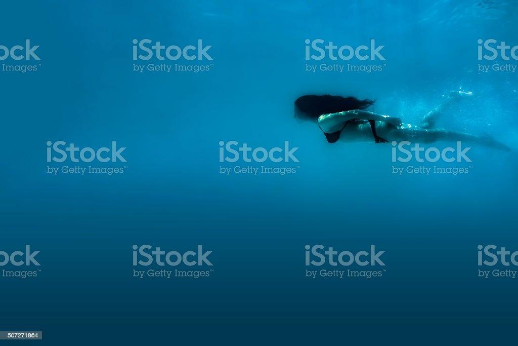 Beautiful Woman Diving Swimming Underwater stock photo