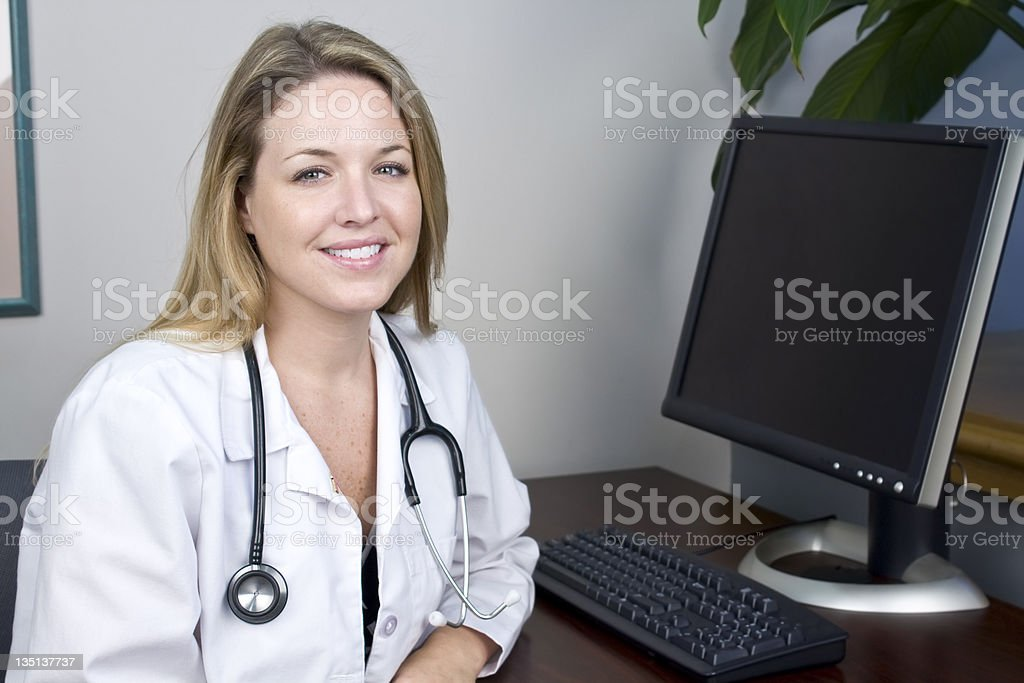 Beautiful Woman Doctor at Desk royalty-free stock photo