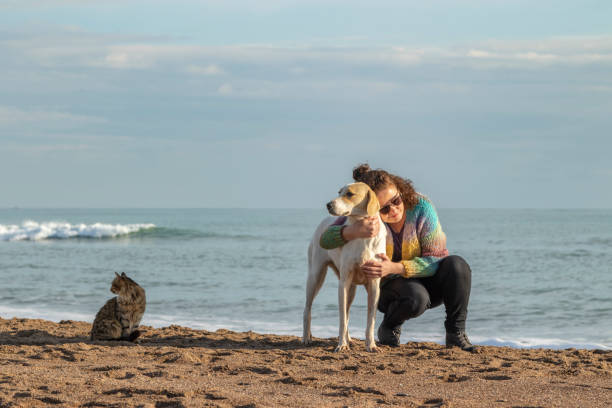 Beautiful woman dog and cat on beach picture id1125246031?b=1&k=6&m=1125246031&s=612x612&w=0&h=hwyw hw5lqabf skfdxtptaqb0v8ho4crk9gkq22gye=