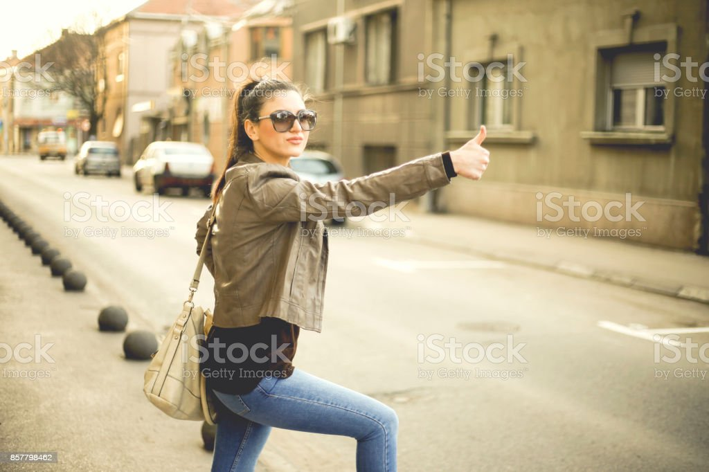 Beautiful woman doing autostop stock photo