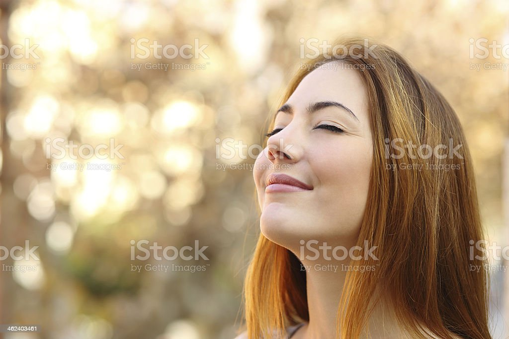 Beautiful woman doing breath exercises with an autumn background stock photo