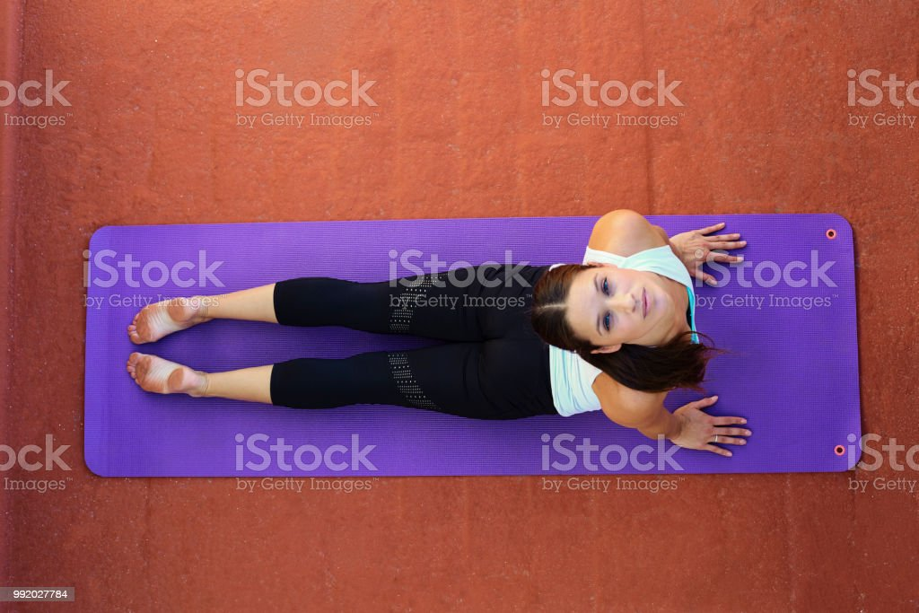Beautiful woman doing exercises stock photo