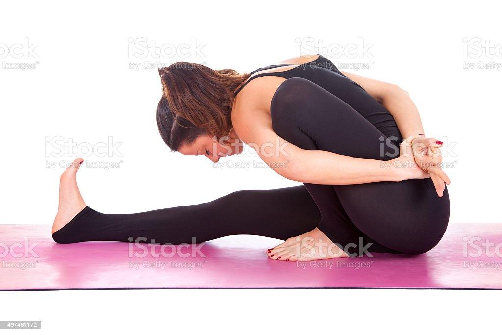Beautiful woman doing Marichyasana asana pose stock photo