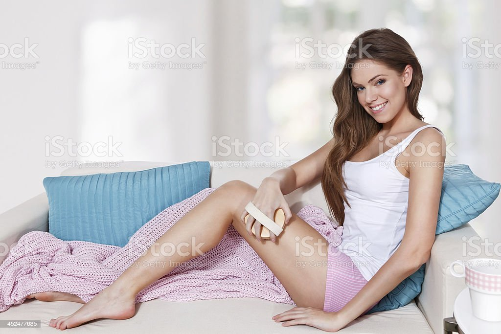 Beautiful woman doing skin care at home stock photo