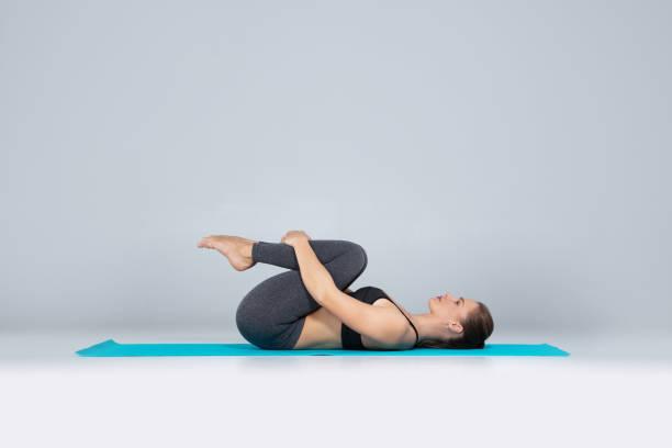 Beautiful woman doing sport exercises on mat stock photo