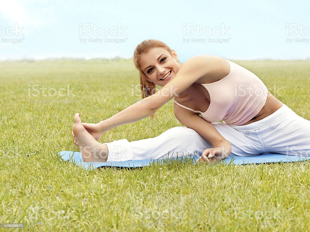 Beautiful Woman doing Stretching Exercise against Nature Backgro royalty-free stock photo