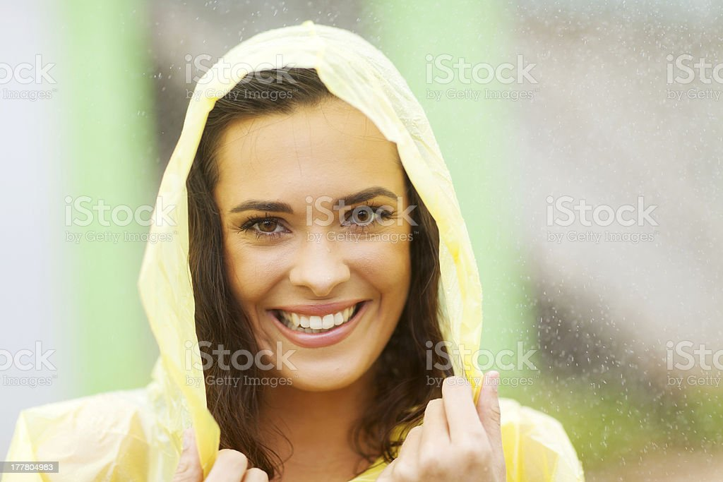 beautiful woman dress in raincoat stock photo