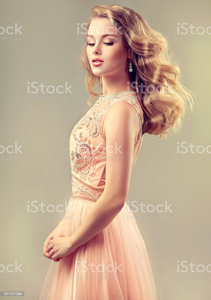 Beautiful woman, dressed in evening gown. stock photo