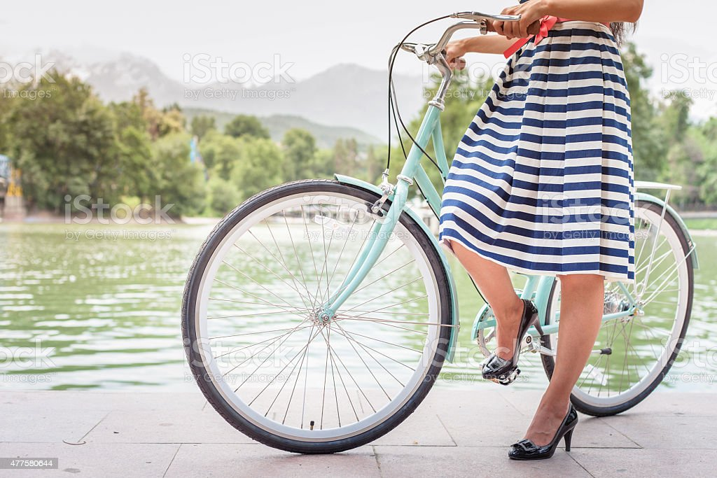 beautiful woman dressed in fashion dress travel by vintage bicycle stock photo