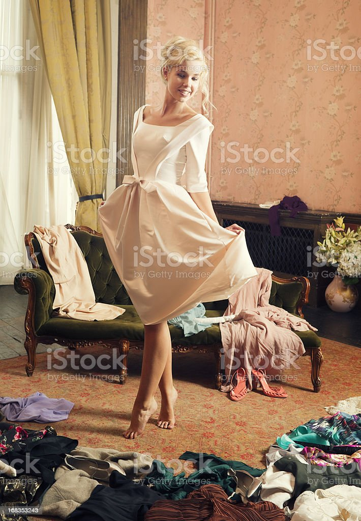 Beautiful Woman, Dressing Room, Clothing Scattered royalty-free stock photo