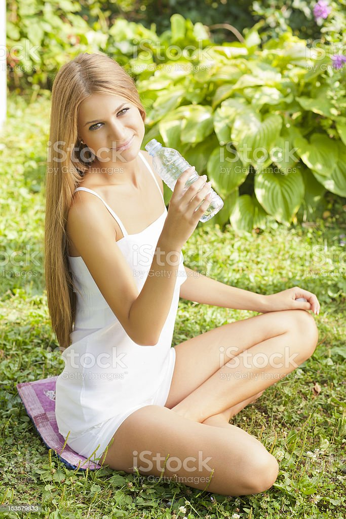 Beautiful Woman Dring Water In Nature royalty-free stock photo