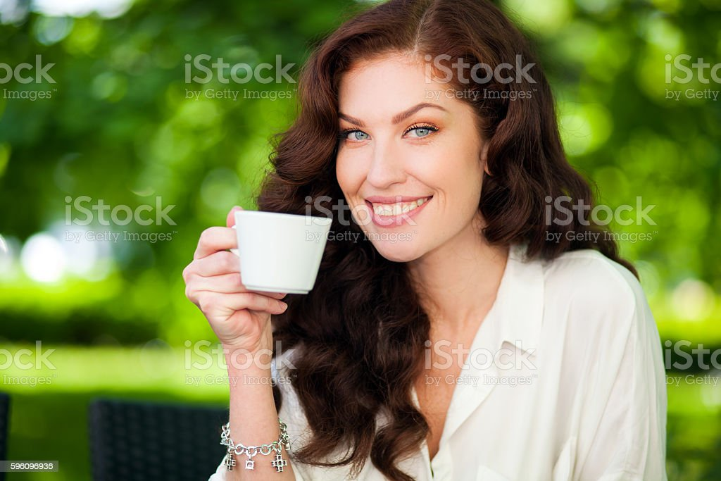 Beautiful woman drinking a coffee outdoor royalty-free stock photo