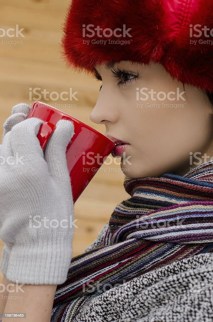 Beautiful woman drinking a hot tea in winter time royalty-free stock photo