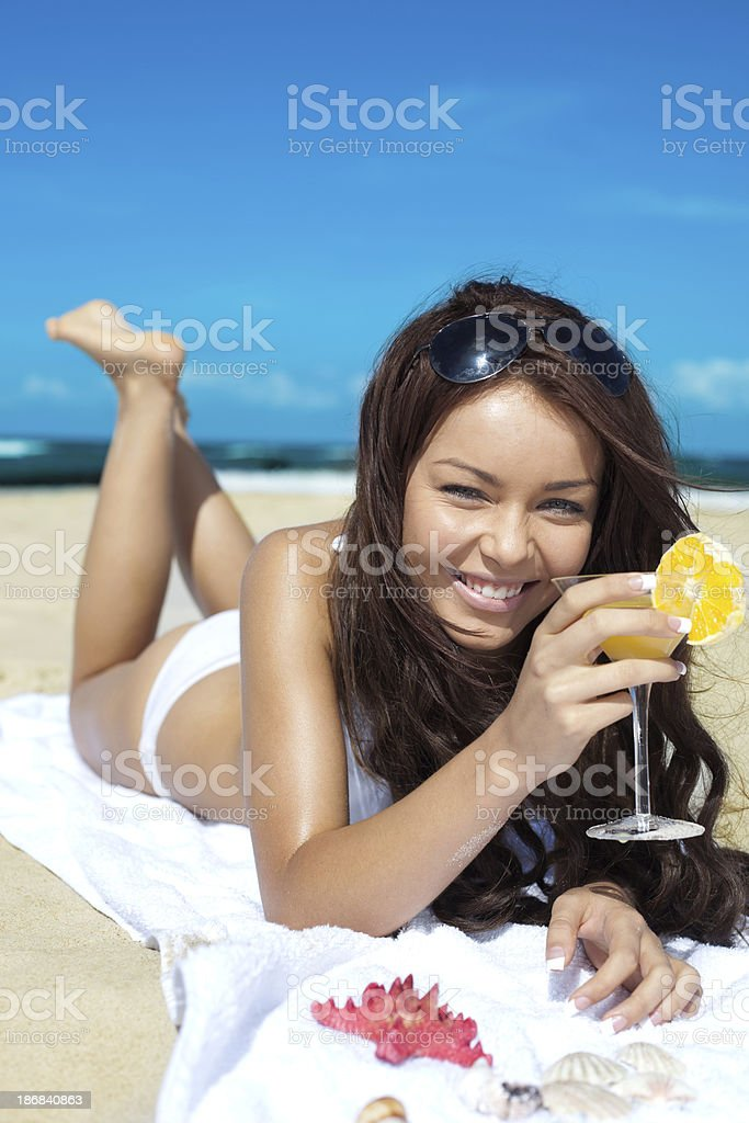Beautiful Woman drinking cocktail on the beach royalty-free stock photo