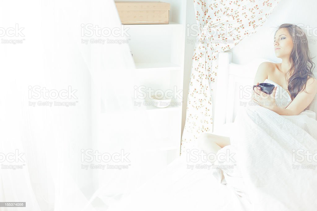Beautiful woman drinking coffee royalty-free stock photo