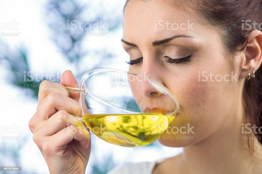 Beautiful woman drinking herbal tea stock photo
