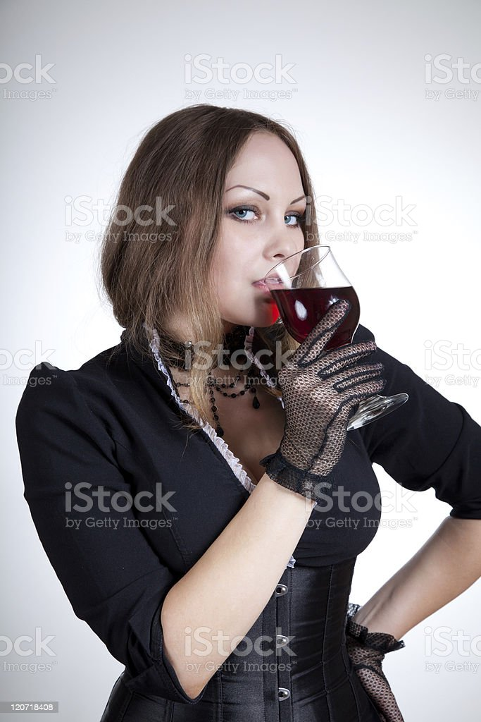 Beautiful woman drinking red wine royalty-free stock photo